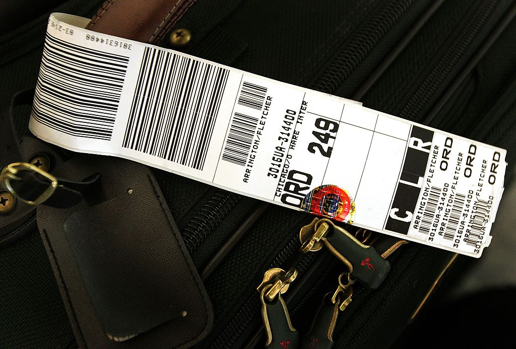 963bd7159107 This Is How Those Airline Luggage Tags Get Your Bags to the Right Place