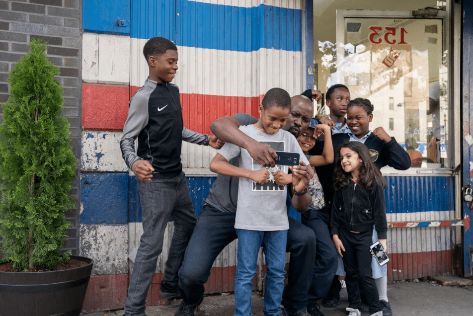 Luke Cage with children in Harlem in Season 2