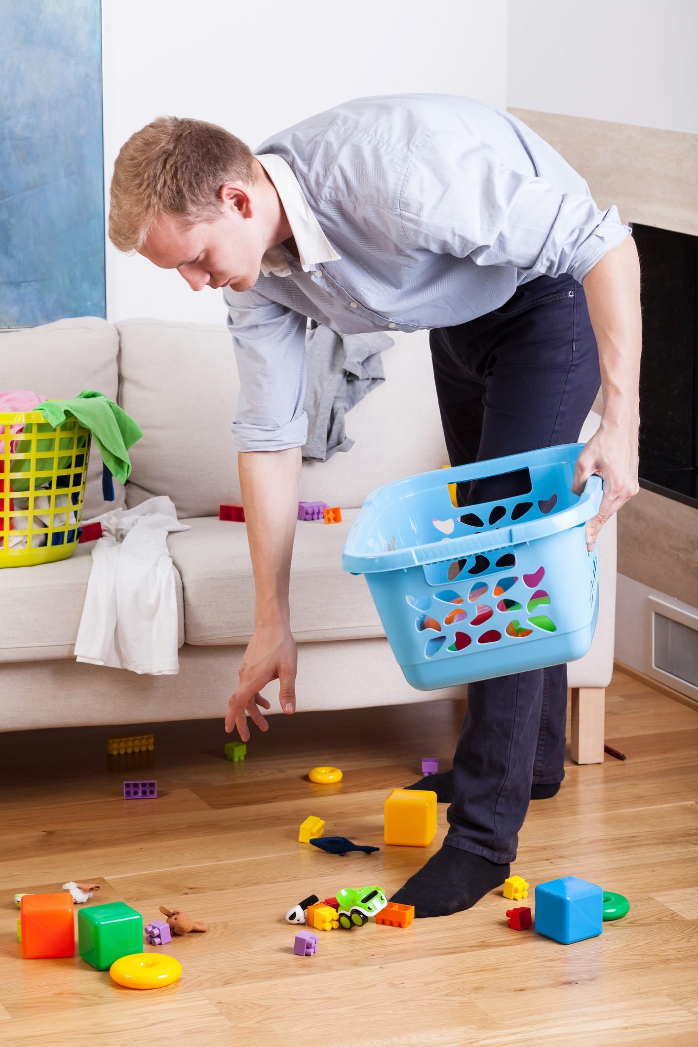 Man organizing toys