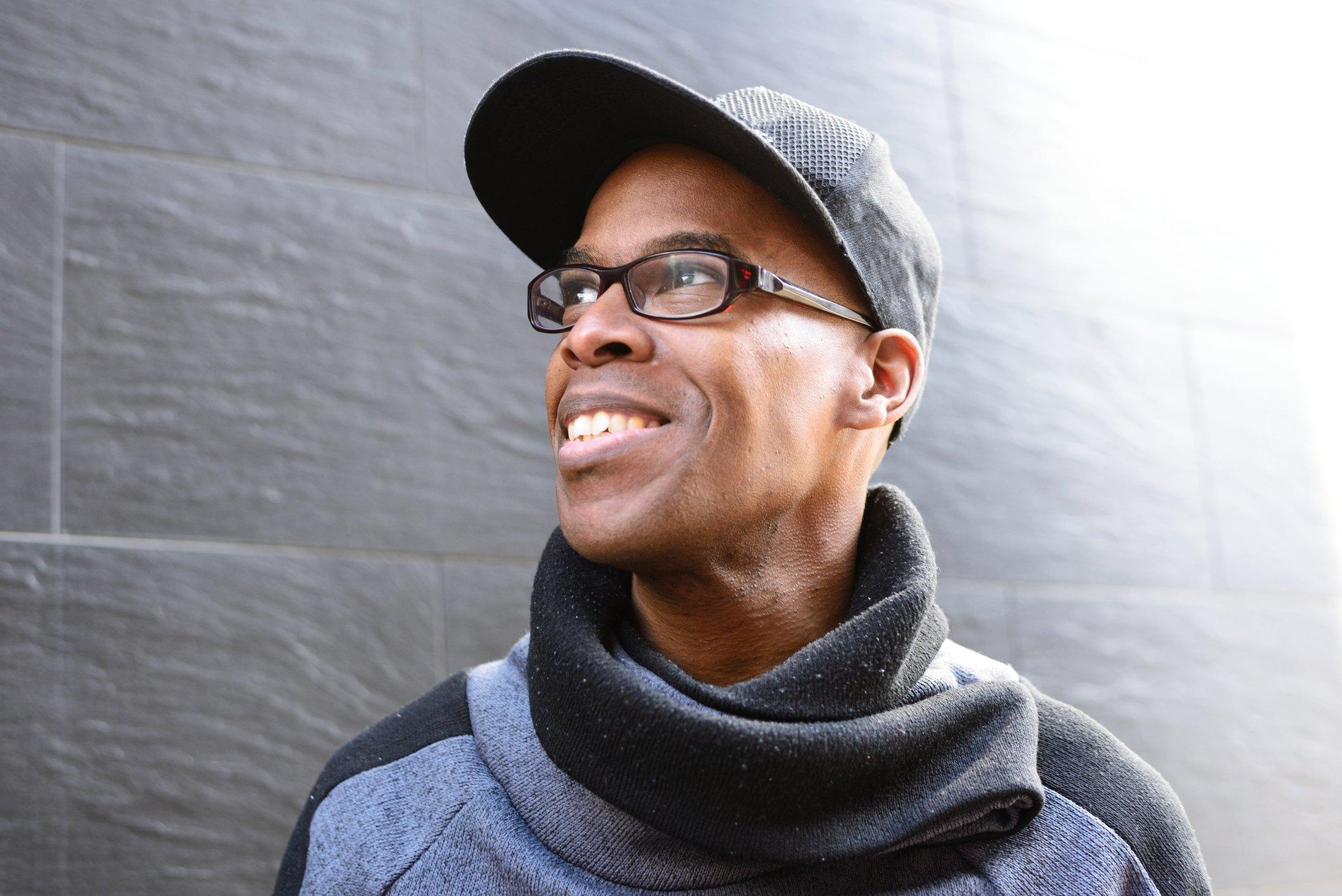 Smiling man in baseball hat