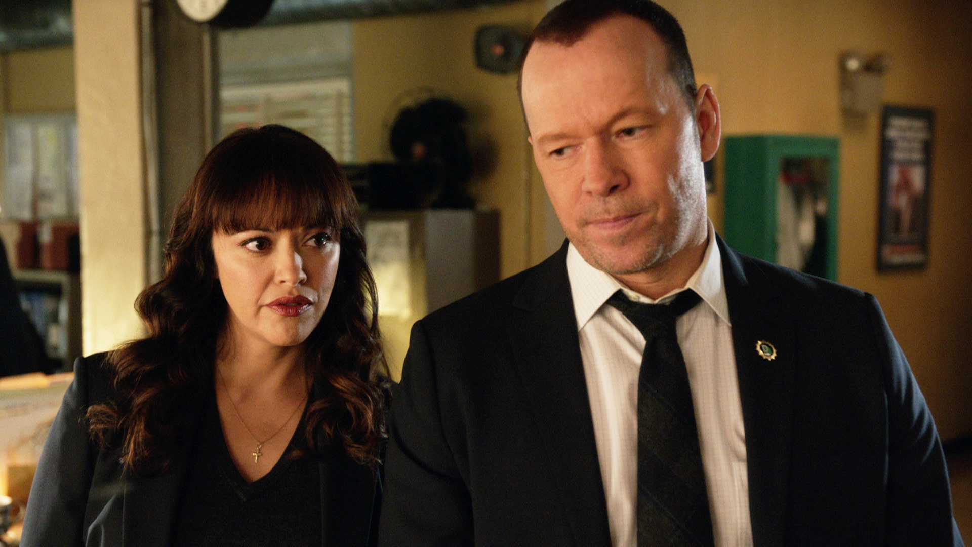 Marisa Ramirez as Maria Baez and Donnie Wahlberg as Danny Reagan stand next to each other on Blue Bloods