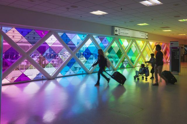 A family travels through the Miami International Airport.