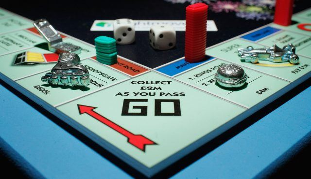 Monopoly board game on a table.