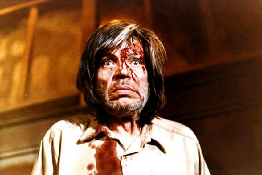Neville Brand as Judd in Eaten Alive with blood on his face and shirt