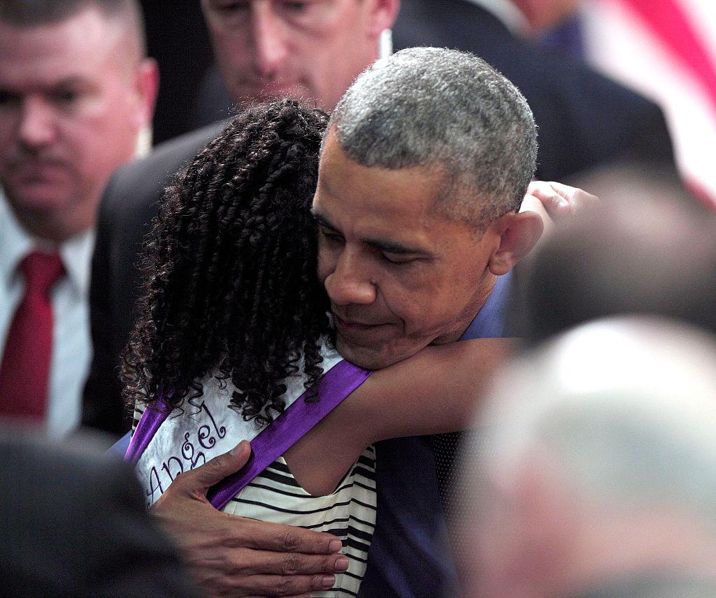 Obama comforts Flint victim