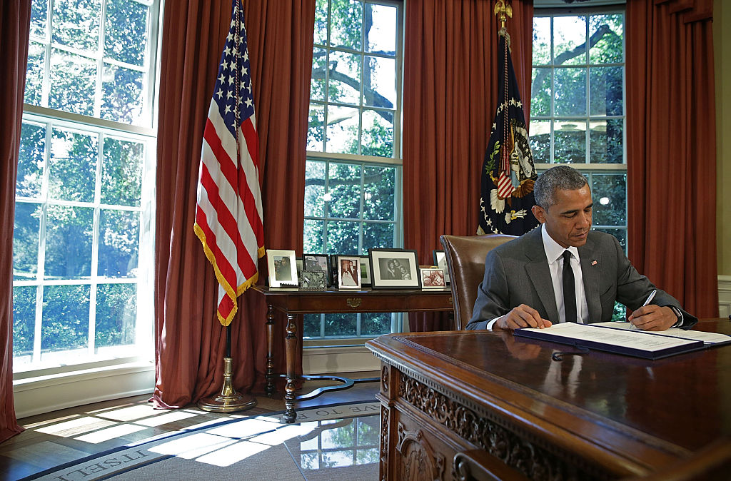 President Obama Signs Bill In Oval Office