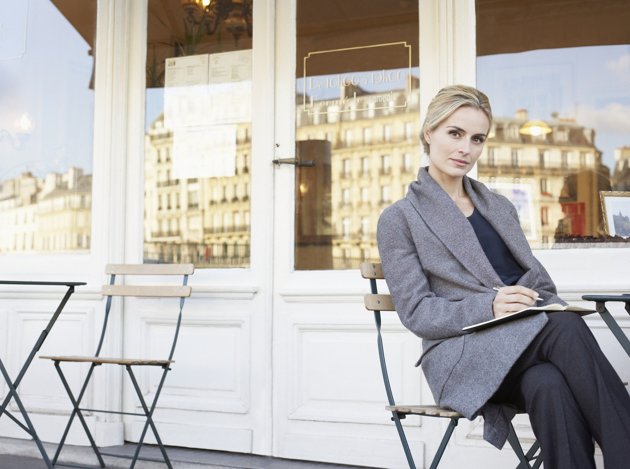 Serious woman sitting on patio
