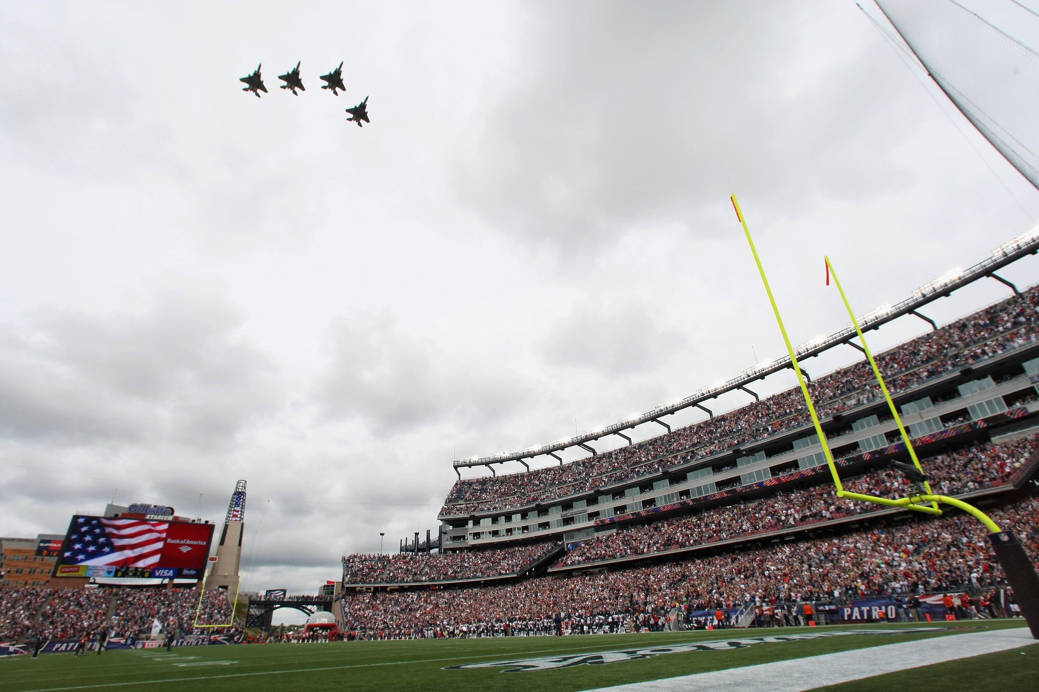 Jets flying over football field