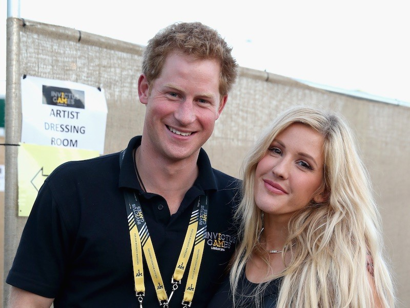 Prince Harry and Ellie Goulding smile and pose next to each other