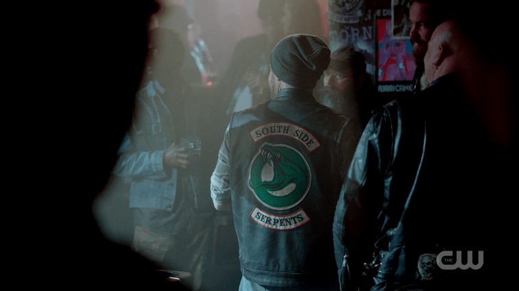 A member of the South Side Serpents wearing the gang's jacket on Riverdale