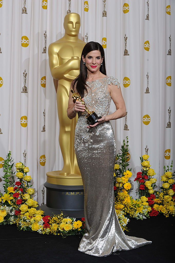 Sandra Bullock poses with the Oscar statue she won for The Blind Side.