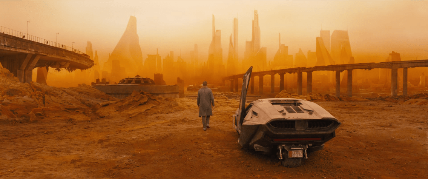 A man walks into a deserted futuristic landscape