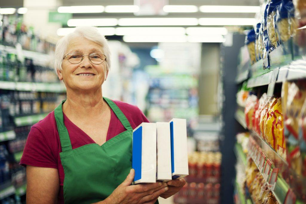 older woman working in a supermarket