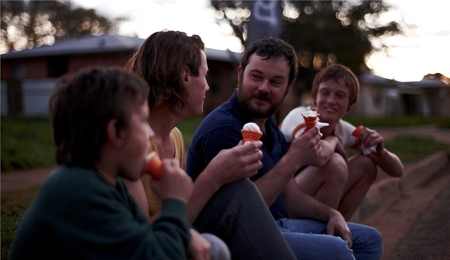 Daniel Henshall as John Bunting eating ice cream with three boys in Snowtown