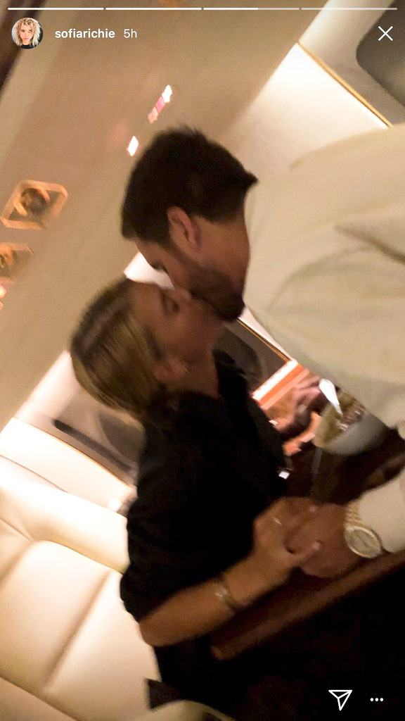Sofia Richie and Scott Disick kissing on a plane