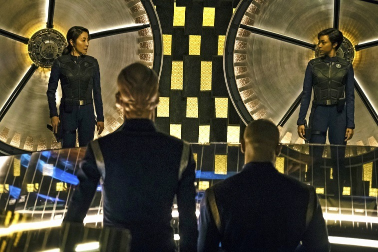 Two women look at each other in Star Trek: Discovery across the room from two men