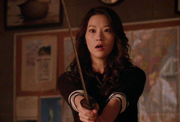 Arden Cho holds up a sword in Teen Wol
