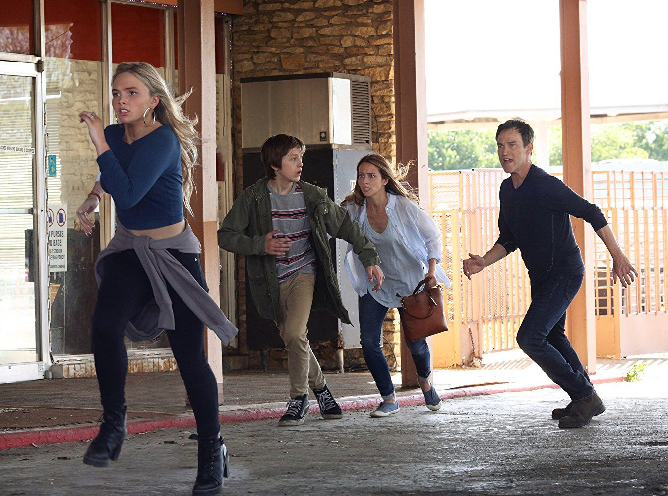 Lauren, Andy, Caitlin, and Reed Strucker running in front of a building