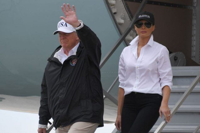 Trump and Melania departing a plane.
