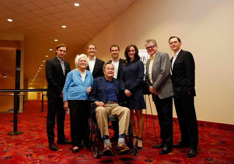 Heather Lind and the rest of the team behind Turn: Washington's Spies take a photo with George H.W. Bush