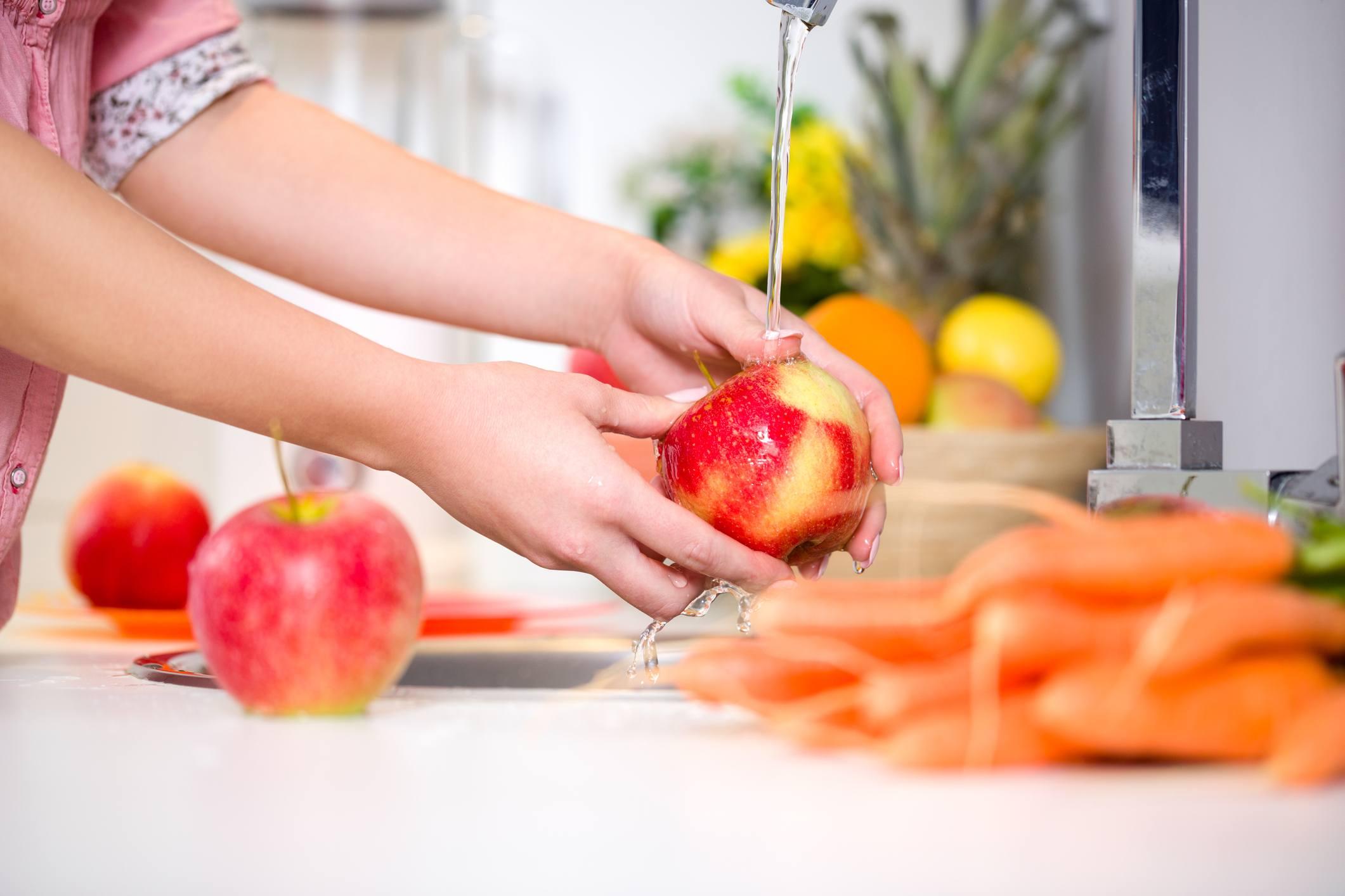Woman washing fruit