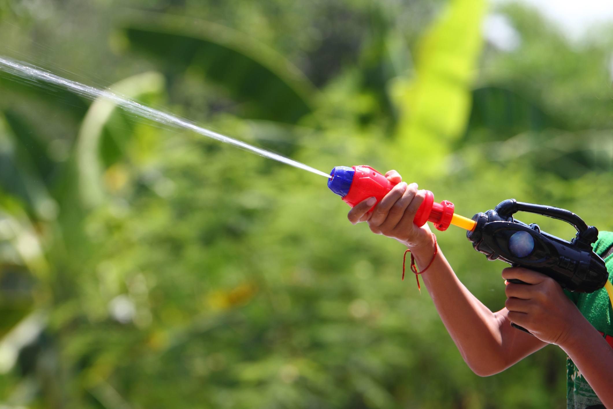 Child with water gun
