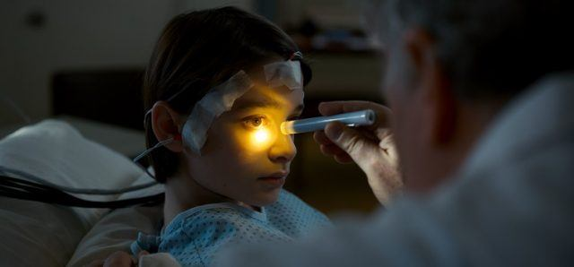 Will Byers being examined by a doctor.