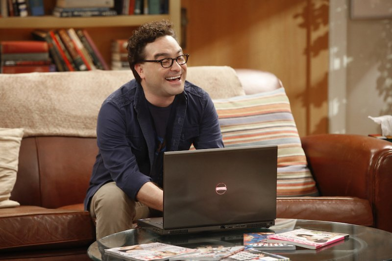 Leonard Hofstadter sits on a couch in front of a laptop