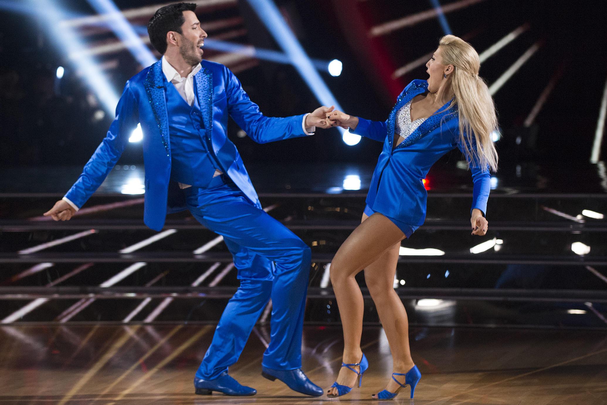 Drew Scott and Emma Slate dancing in blue costumes