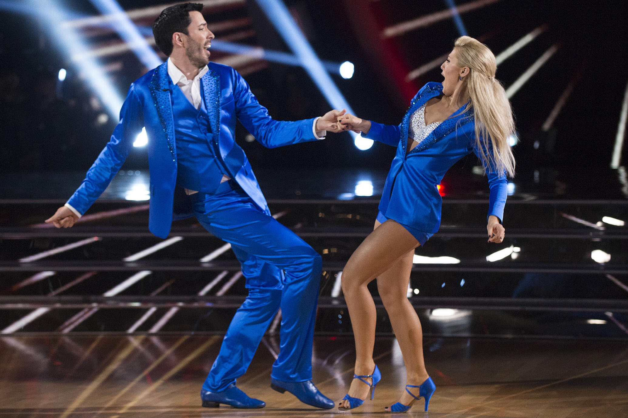 Drew Scott and Emma Slate dancing in blue costumes