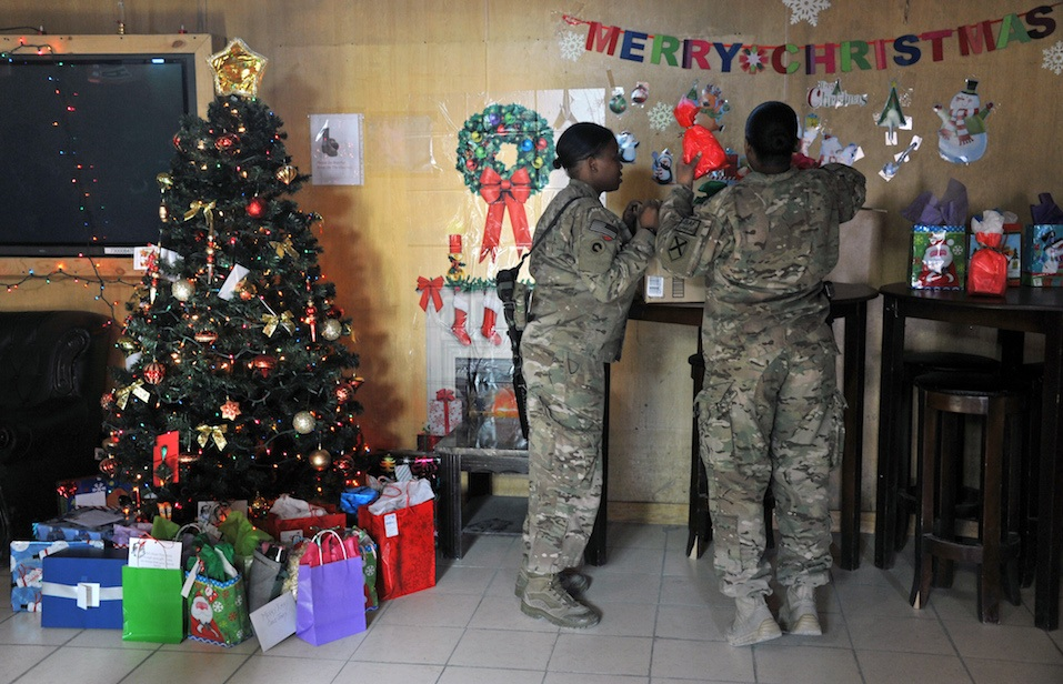Soldiers with the NATO-led during a special meal on Christmas Day at a military base in Kabul