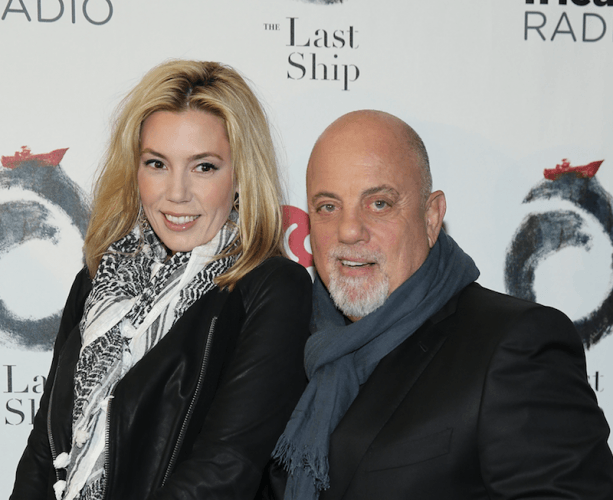 Alexis Roderick and Billy Joel pose for photos on a red carpet.