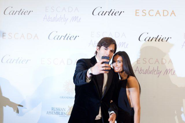 Ashton Kutcher and Demi Moore take a selfie together.