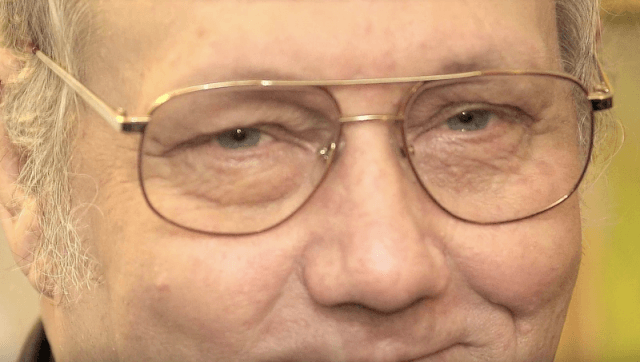 Billy Bob Harrell Jr. wearing glasses and smiling.