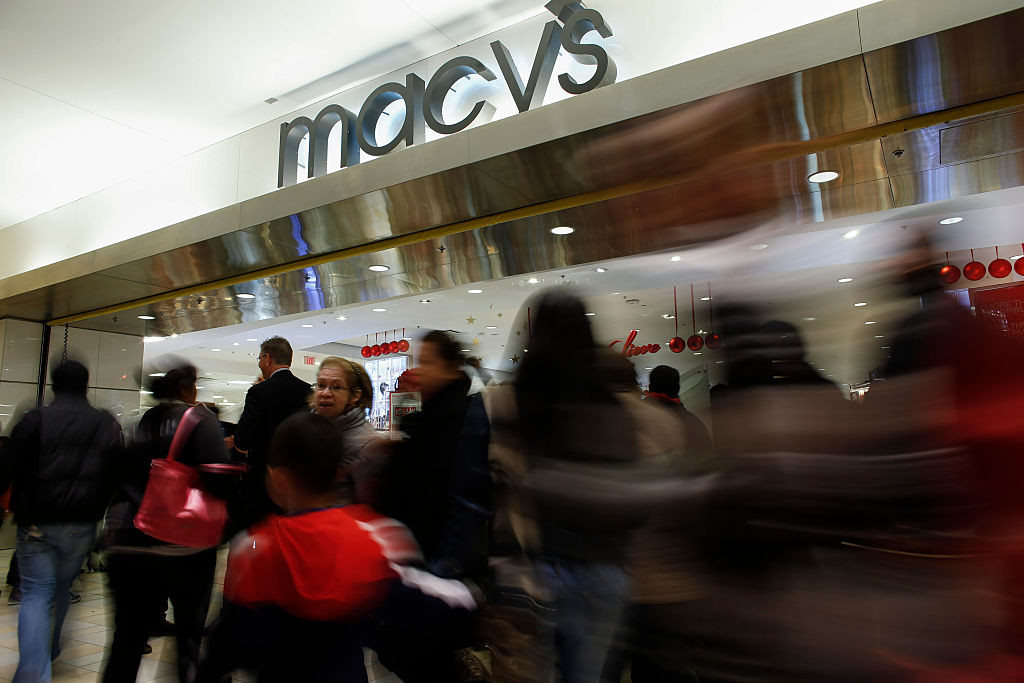 People enter to Macy's store at the Newport Mall