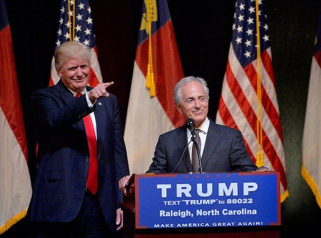 Donald Trump smiling and pointing his index finger while standing next to Bob Corker.