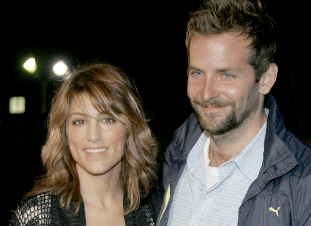 Bradley Cooper posing with Jennifer Esposito on a red carpet.