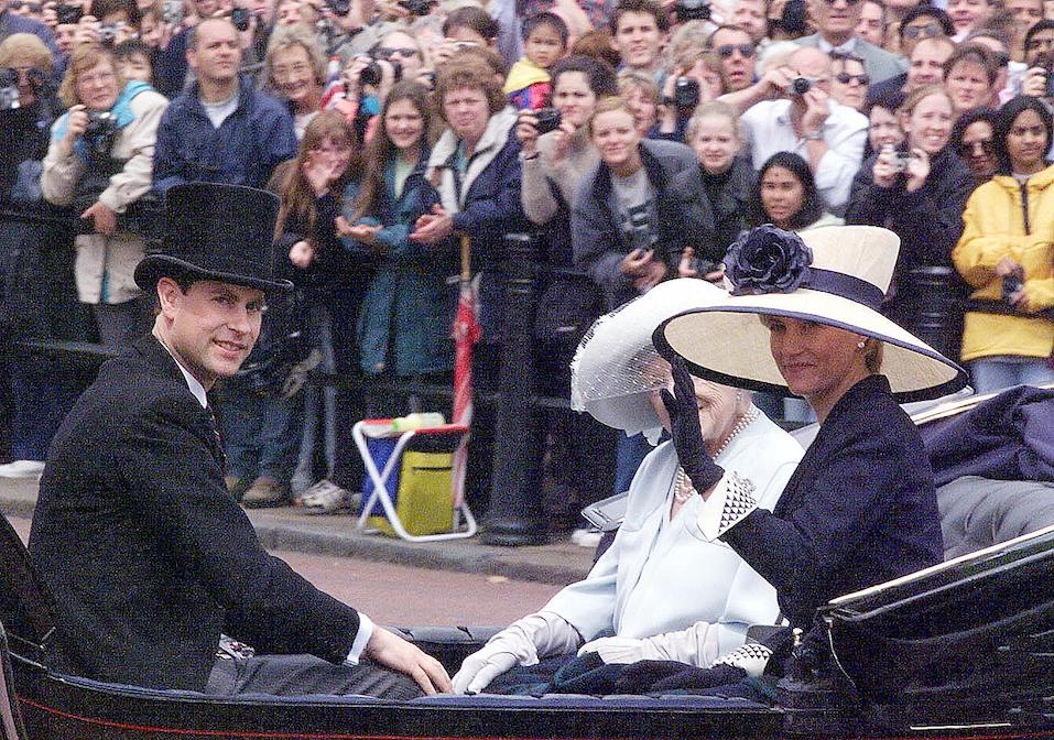 Britain`s Prince Edward accompanied by his fiance Sophie Rhys-Jones ride in the Queen Mother`s carriage