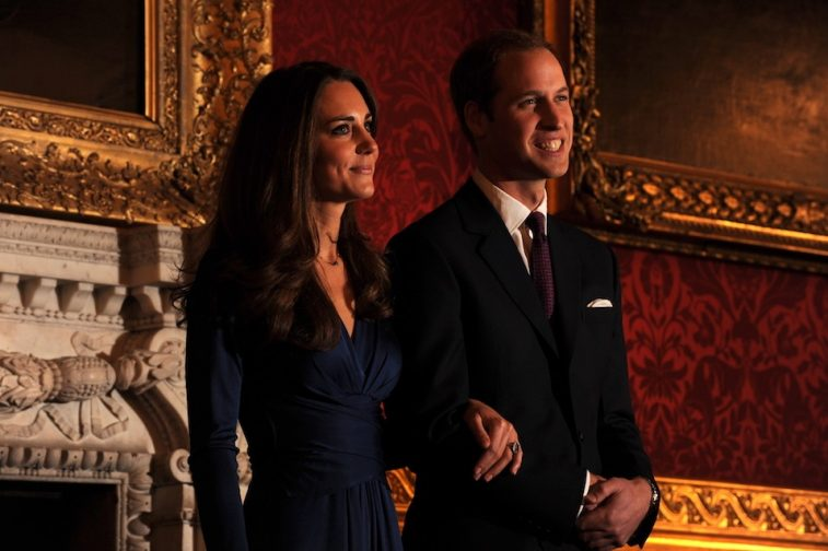 Britain's Prince William and his fianc?e Kate Middleton pose for photographers