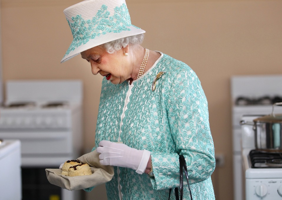 Britain's Queen Elizabeth II looks at homemade scones