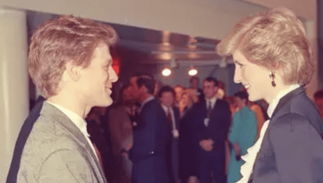 Princess Diana chats with Bryan Adams at an event.