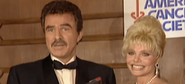 Burt Reynolds and Loni Anderson speak at a charity event.