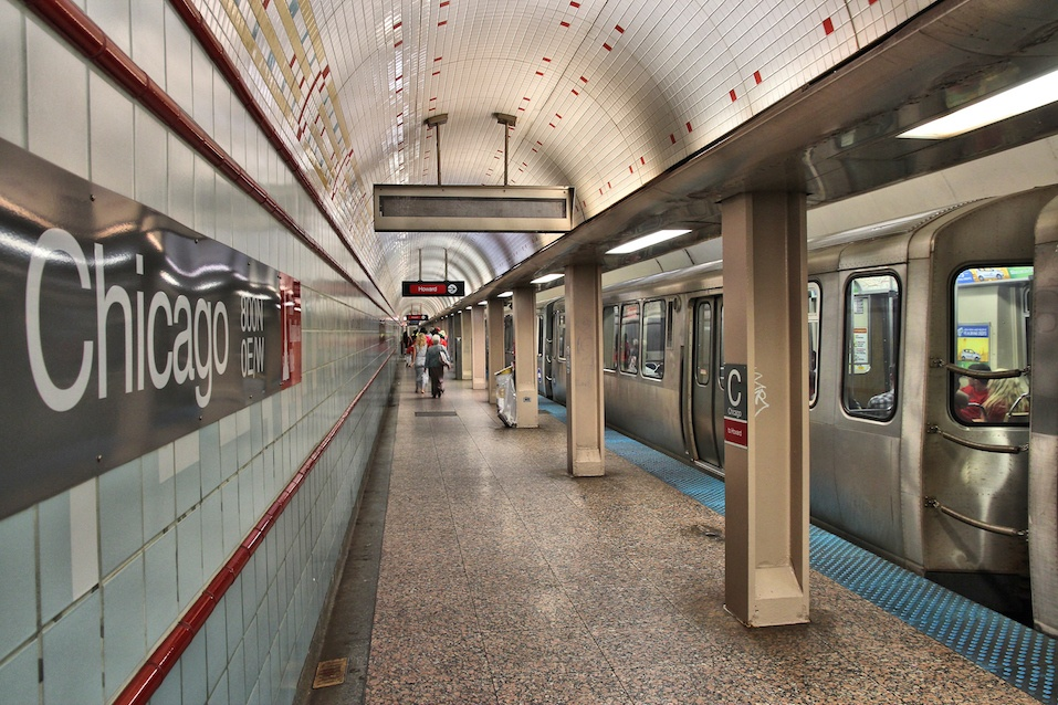 People exit underground station of Chicago's elevated train
