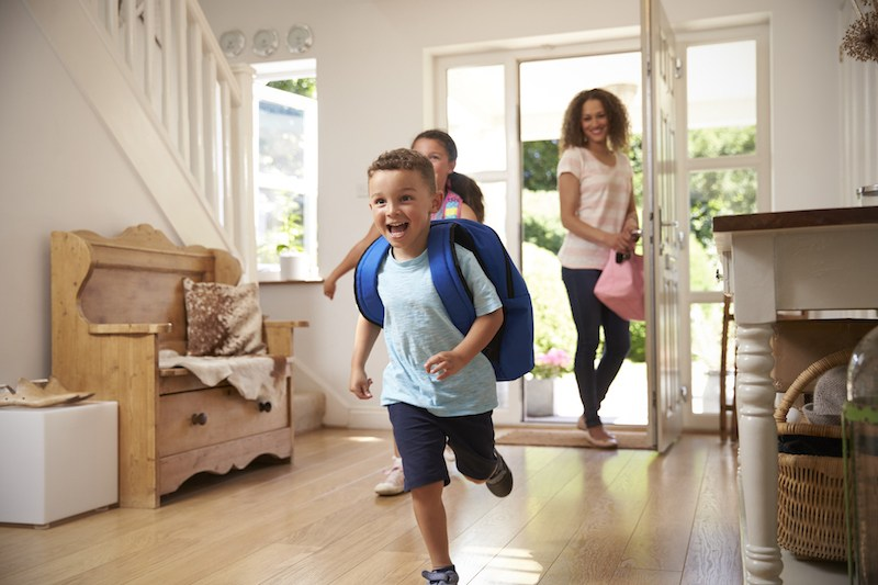 Children race into a home.