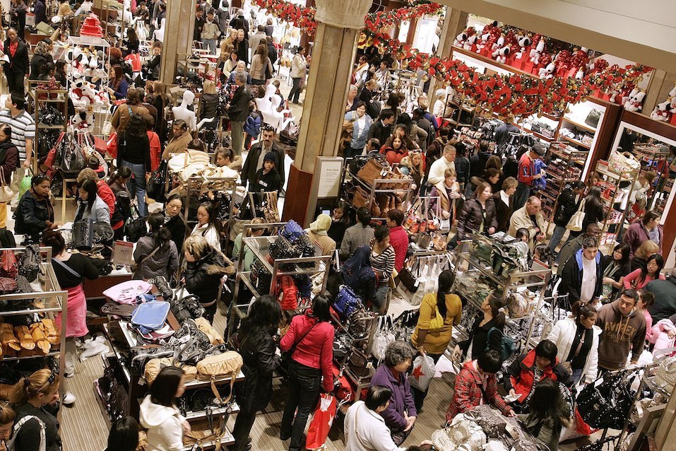 Shoppers crowd the floor at Macy's the day after Thanksgiving November