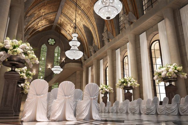 Church Cathedral wedding interior with rows of elegant chairs and flowing flower arrangements