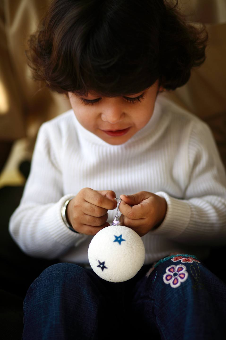 Girl holding a bauble