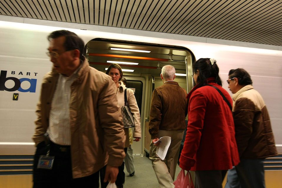 Bay Area Rapid Transit (BART) riders exit a train at the Powell Street station