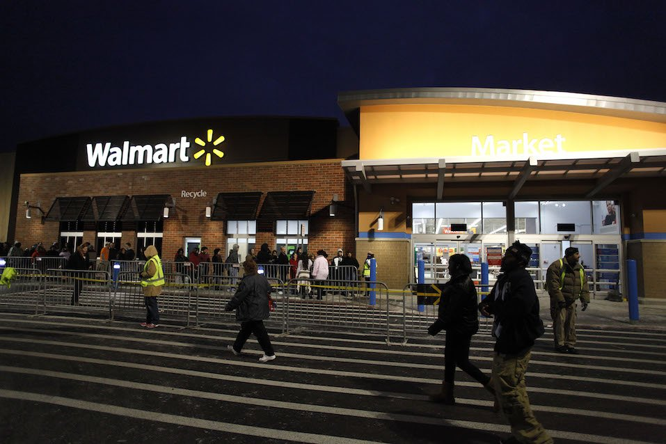 Customers wait in line to enter Wal-Mart Thanksgiving day
