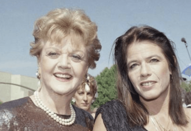 Angela Lansbury and Deirdre Shaw smiling together while posing for the paparazzi.